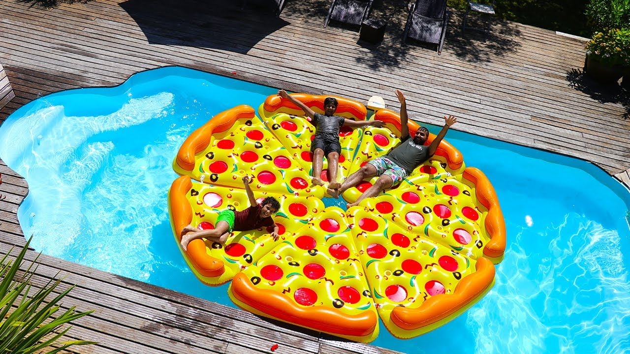 Photo of children play with a giant inflatable pizza in Swimming Pool, funny videos for kids
