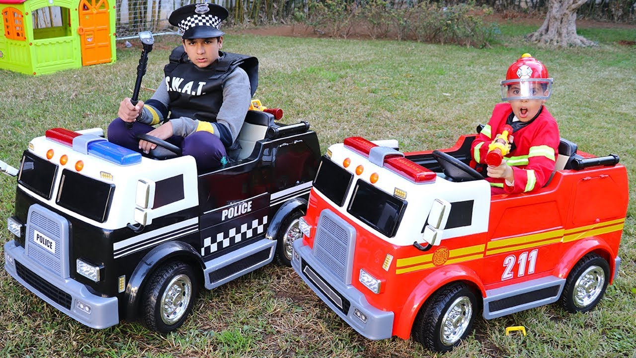 Photo of children play with fire truck and police truck ,funny videos for kids, adel et sami